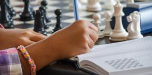 student plays chess
