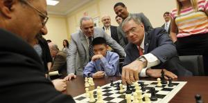 Rep. Chaka Fattah (D-PA) and Garry Kasparov watch as Jeffrey Xiong and Rep. Blaine Luetkemeyer (R-MO) make their next move at the first-ever Congressional Chess Match in Washington, DC. (Photo by Paul Morigi/AP)